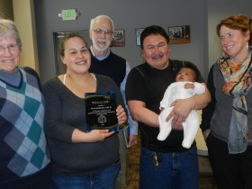 Left to right: Cyndy Langmade, PA-C, Tania McMullen, CHA III, Dr. Cooper, Moose Anahonak holding Tania's daughter Cyborg, and Dr. Cotton.